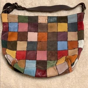 Vintage multi color suede and leather patch bag.